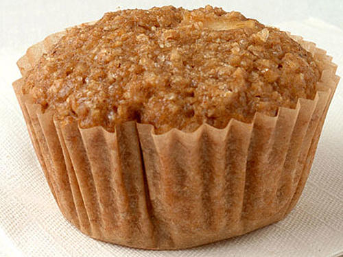 Oat bran, the outer casing of an oat, is high in fiber. Apples and applesauce make these healthful muffins sweet and moist. If making ahead, individually wrap cooled muffins, and freeze for up to one week.