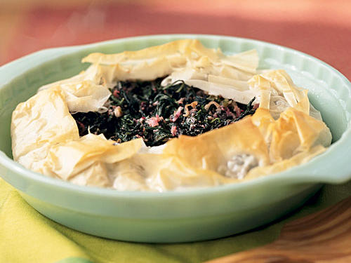 Flaky phyllo, fresh flavor, and the vitamins-and-minerals punch of greens make this pie a taste and nutrition powerhouse. It'll serve eight as a stylish dinner-party starter or four as a vegetarian main course for the family.