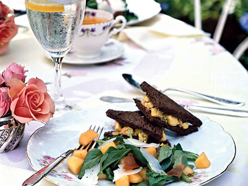 Throw an inviting outdoor luncheon fit for a bridal shower or a spring birthday celebration featuring Curried Chicken Salad Sandwiches, fresh Melon, Serrano Ham, and Arugula Salad, and Truffled Asparagus Crostini. Send guests home with Lemon Angel Food Cupcakes as delightful party favors.View Menu: Garden Party