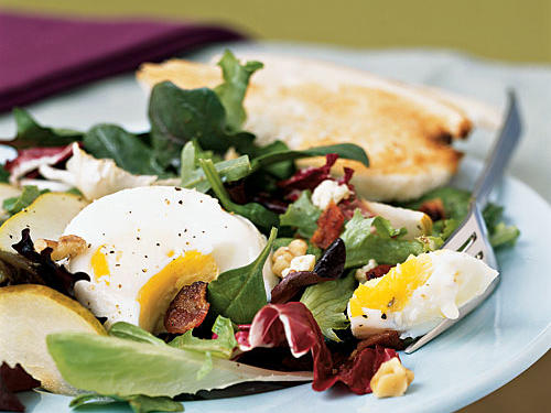 This has all the elegant elements of a restaurant salad―fresh-toasted walnuts, soft-cooked eggs, crumbled bacon, tangy blue cheese, and crunchy pear―but it takes just 10 minutes or so to make. A teaspoon of bacon drippings in the tarragon-Dijon vinaigrette makes it extra rich-tasting and flavorful.