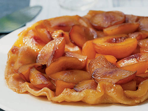 This impressive-looking dessert is a tasty way to showcase nectarines. Using a stainless-steel skillet makes it easier to see when the sugar has caramelized, but you can use a nonstick pan. You'll use the same skillet to prepare the tarte tatin like an upside-down cake, layering pie dough over the fruit and finishing it in the oven. The tart is great served warm with low-fat vanilla ice cream.