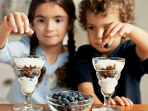 "Getting plenty of good bacteria, also known as probiotics, is key to keeping little stomachs happy and healthy, and yogurt is a great source of this bacteria. Limit sugary versions aimed at kids because these are often lower in protein and good bacteria. Instead, choose plain nonfat or low-fat yogurt or Greek yogurt and dress them up with a spoonful of honey and sprinkling of fresh fruit. Look for the words ""live and active cultures"" on the carton to ensure that the yogurt has plenty of beneficial bacteria.  Don't forget too that a cup of yogurt counts towards your child's daily dairy servings. Most yogurts actually have more calcium than a cup of milk.Kids will love to assemble their own Blueberry and Maple-Pecan Parfaits."