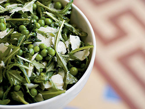 English peas and mint are a classic combination, given extra depth of flavor here with the addition of savory pecorino and bitter arugula. Fresh lemon juice (always better than bottled) in the dressing brightens all the flavors. Crumbled feta or goat cheese make excellent substitutes for pecorino, and if you can't find fresh English peas, try green beans or sugar snap peas, or use frozen.