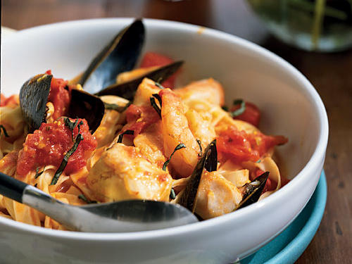 As bivalves like mussels and clams cook, they open up and release a marvelously flavorful liquid, which you should never, ever let go to waste. This dish uses pasta to soak it up, but you could even leave out the pasta and serve the dish as a stew, with plenty of good bread for sopping. Like its Mediterranean namesake, this recipe can use any combination of seafood you have on hand: The simple herbs-and-tomato sauce works with lobster, crawfish, salmon, tilapia, oysters, scallops, and more.