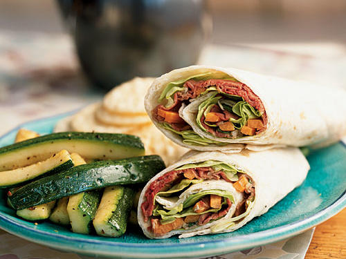 Get Asian flavor on the go with these no-cook, make-ahead, easily portable wrap sandwiches. Deli roast beef is dressed up with a sesame-and-lime dressing in a three-minute sandwich that will make you the envy of the lunchroom. Make a batch and stick them in the fridge for a great grab-and-go supper on busy nights.