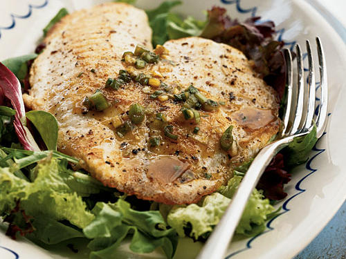 Tilapia's a great fish―inexpensive, mild-flavored, and easy to find at any supermarket―and a great way to add lean protein to your diet. This recipe coaxes nice, balanced flavor from a six-ingredient dressing that's as great on the fish as on the salad greens over which it's served.