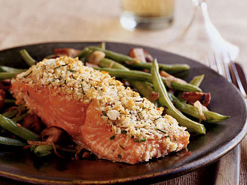 In this simple entrée, almonds supply vitamin E, while salmon delivers a good amount of niacin. Vary the herbs according to your preference; try dill, thyme, or basil.