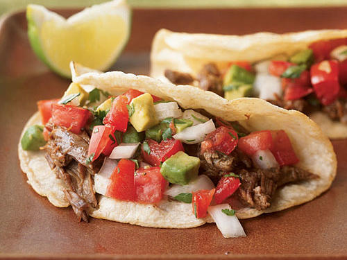 These simple tacos are an ideal showcase for tender Beef Carnitas—tender, slowly cooked, inexpensive beef stew meat that won us over for its great flavor and versatility. You can warm the tortillas in a nonstick skillet just until lightly browned.