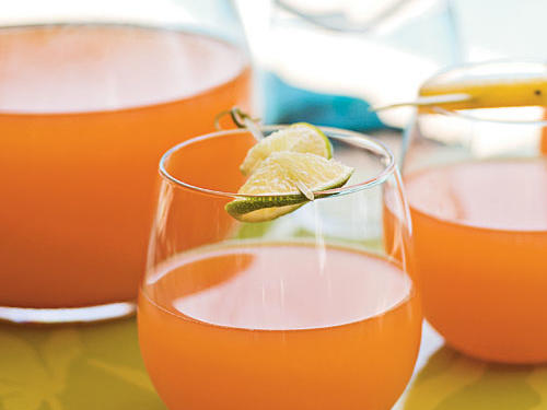 "It's hard to beat the relaxing Caribbean flavors of this fruity rum punch. ""I made this punch for a Girls' Night party. It was a big hit,"" raves Theresa. ""I couldn't refill the punch bowl fast enough!"""