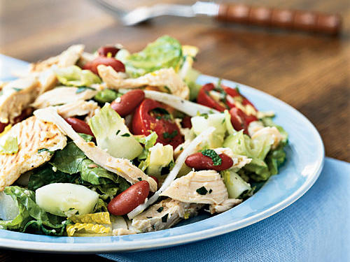 The classic version of this Middle Eastern bread salad is tasty and quick, with lots of vegetables and torn pita bread in a bright lemon vinaigrette, but it's not a full meal. We added chicken and kidney beans to make this a filling main dish without sacrificing any of the original flavor or increasing the prep time.