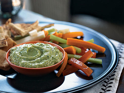 Scoop this creamy dip with pita chips and carrot, celery, red bell pepper, and jicama sticks. Prepare up to eight hours in advance, and refrigerate in an airtight container. To further simplify prep work, use precut vegetables from the produce section.