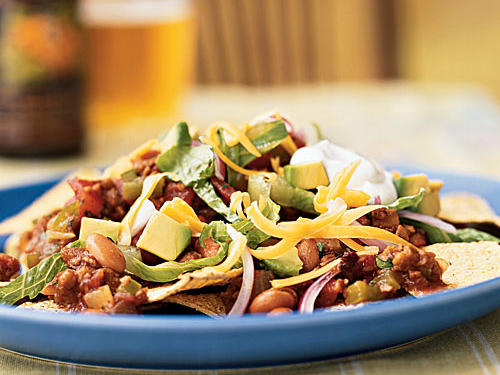 With nachos, the more healthful toppings you can pile on top, the better. This dish delivers, with spicy chipotle, beans, tomatoes, lettuce, avocado, onion, cheese, sour cream, and more. The vegetarian crumbles are almost indistinguishable from ground beef (except in the nutrition department), but die-hard carnivores can replace it with lean ground beef.