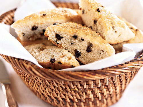 Enjoy these barely-sweet scones with strawberry jam and a spot of tea. Try substituting other dried fruits, such as cranberries or blueberries, for the currants.
