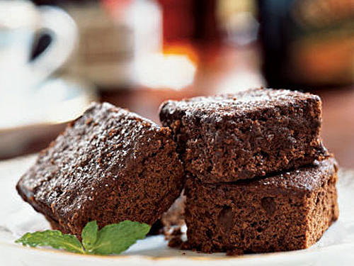 For truly fudgy treats, be sure to cook the brownies until a wooden pick inserted in the center comes out almost clean. If you wait until the pick is clean, the brownies will be overcooked. Garnish the plate with a sprig of mint.