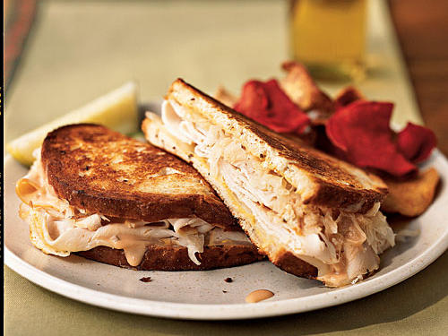 Using smoked turkey instead of corned beef cuts down on saturated fat, but everything else―Swiss cheese, sauerkraut, Thousand Island dressing, and rye bread―is pure deli classic. Toasting in the pan makes these warm and melty, but you can skip that step and save six minutes.