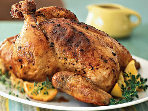 This recipe comes from the Sephardic Jewish cuisine of Spain and North Africa. A simple seasoning of lemon, paprika, and thyme gives the chicken Mediterranean flavor, and high-temperature roasting ensures beautifully browned skin. An easy gravy made from the drippings completes the dish, making it suitable as a weeknight family meal or as the centerpiece to a small dinner party.