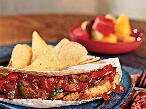 Inexpensive catfish is good for more than just frying. Here it's combined with lots of vegetables for a fresh fajita. Try replacing the pico de gallo with fresh guacamole for a great variation, or ditch the tortillas and serve the fish over rice and beans.