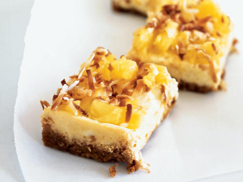 Channel the tropics with these cheesecake bars that feature fresh, in-season pineapple. This recipe uses a small amount of coconut flour, which is slightly sweet, high in fiber (3 grams per tablespoon), and gluten-free. Look for it in health-food stores or order online from Bob's Red Mill. You also can substitute an equal amount of all-purpose flour.