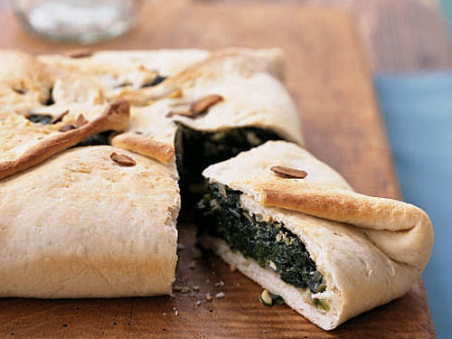 This one-dish meal is a cross between a vegetarian calzone and the classic Greek dish spanakopita.