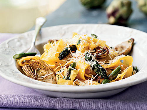 Beautiful ribbons of pasta intertwine with fresh spring vegetables in a light citrusy dressing. Pappardelle is a wide, flat pasta. If you can't find it, use fettuccine. Be sure to grate the rind before you juice the lemon.
