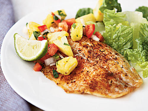 Fresh pineapple chunks, now widely available in supermarkets, speed the prep for this relish. Round out this tilapia dish with a romaine lettuce salad tossed with lime dressing.