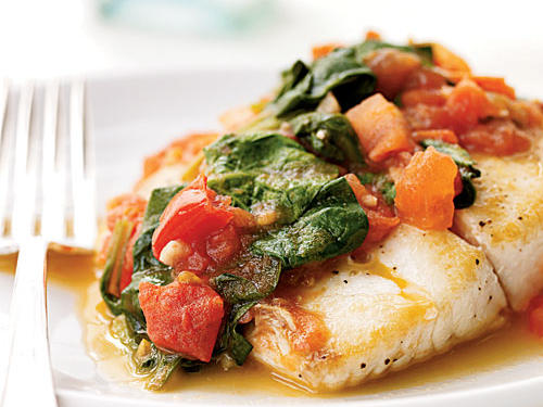 The acidity of tomatoes and white wine and the slight bitterness of spinach make a nice counterpoint to mild-flavored snapper in this simple-but-elegant dish. Many kinds of fish make great substitutes here―cod, halibut, even salmon. Pair with a lightly dressed or sauced pasta for an easy Mediterranean meal.
