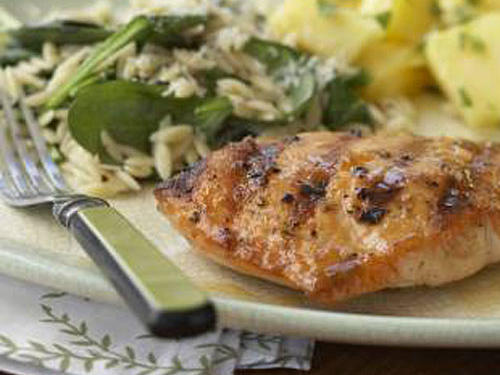 Friends and family will beg for the recipe when you serve this sophisticated take on salmon. Brush the fruit reduction on the fish at the last minute to prevent sugars from burning on the grill.