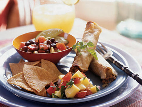 "Taquito means ""little taco,"" and these are a vegetarian delight. They're filled with savory ingredients and then rolled into cigar-shaped bundles. You can prepare and refrigerate the filling the night before; allow it to stand at room temperature for 30 minutes before assembling the taquitos. Use tongs to dip the tortillas into the simmering broth."
