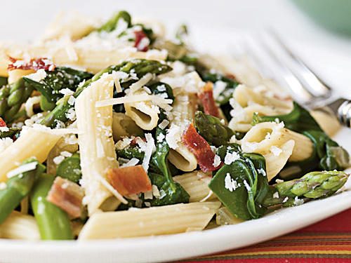 This is a ridiculously easy dish that manages to incorporate a range of great flavors―crisp, salty bacon, fresh, sweet asparagus, savory Parmesan―in less than 10 minutes. The bacon and veggies take about as long to cook as the pasta, and you just toss everything together to serve. Swap in whatever vegetables are on hand to create a quick meal anytime.