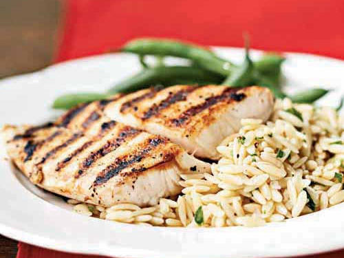 Small rice-shaped pasta, orzo cooks quickly and soaks up flavor from the vinaigrette. Double the vinaigrette and spoon some over the top of the fish, if you like.