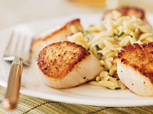 Serve this easy but impressive meal with a green salad, garlic bread, and a crisp white wine. Tip: Sear the scallops while the orzo cooks to save time and ensure the dish stays warm until mealtime.