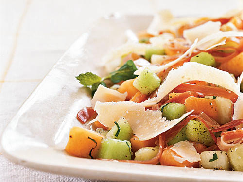 Melon and prosciutto are a classic pairing; Parmigiano-Reggiano (don't skimp―use the real stuff) pumps up their flavor with its deep savoriness. Make this salad the centerpiece of an antipasto meal by serving with bruschetta and an assortment of olives, cheeses, and slices of salami or ham.