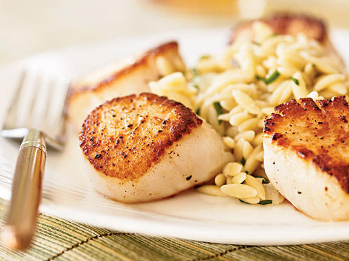 Searing over high heat is the best way to cook scallops―it caramelizes the surface to bring out their natural sweetness while keeping the inside from getting rubbery. The orzo cooks in lemon juice and wine for deep citrus flavor that stands up well to the scallops. For a nice variation, try rice or couscous cooked the same way.