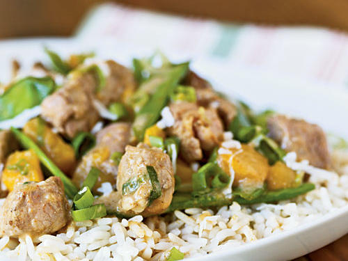 Here's a great Thai version of a quick stir-fry. Curry spice meets coconut-milk creaminess to flavor perennial-favorite pork tenderloin, fresh snow peas, and sweet mango. This dish makes it super-easy to bring something a little exotic to your weeknight table.