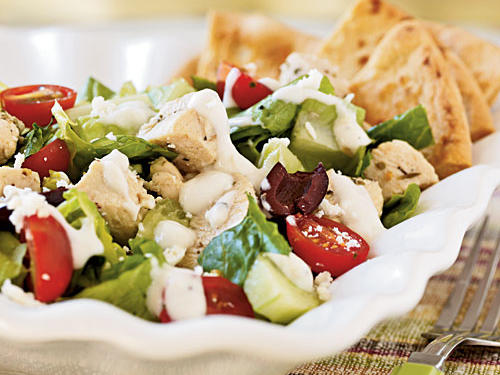 Greek seasoning―as simple as oregano and lemon―pairs fantastically with chicken and forms the base for this fresh and healthful salad. Yogurt and tahini make a creamy dressing, while kalamata olives and feta cheese add their own distinctly Greek flavors to the party. Each large, satisfying serving has only 243 calories.