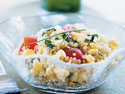 Brightly colored flavored oil coats the quinoa grains and lends the salad fresh chive flavor. Refrigerate leftover oil to use as a dressing to drizzle over grilled fish or summer vegetables. Garnish with whole fresh chives, if desired.