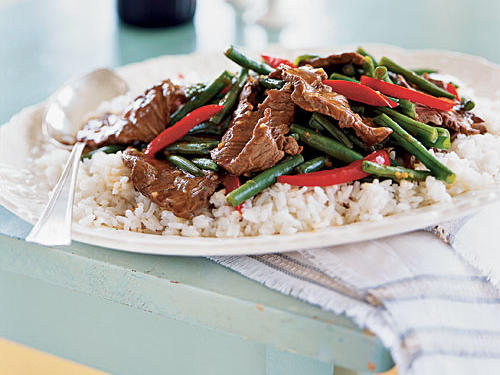 Asian-style stir-fry recipes abound, because they're fast, provide so much flavor, and come in so many varieties. This one pairs tender steak and vegetables with the sweet spice of hoisin sauce and the moderate heat of chili garlic sauce. The colorful result looks great on a bed of white rice, and nobody has to know it took less than 15 minutes.