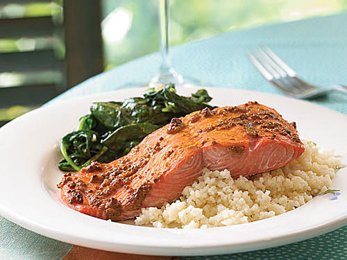 A basic honey mustard adds the unexpected ginger and pepper notes of turmeric to make this dish different. Broiling leaves the salmon moist and tender and caramelizes the sauce slightly for additional flavor. Any kind of greens makes a great side―try kale cooked with hoisin sauce; chard sautéed with garlic, lemon juice, and pepper; or a spinach salad with red onions and vinaigrette.