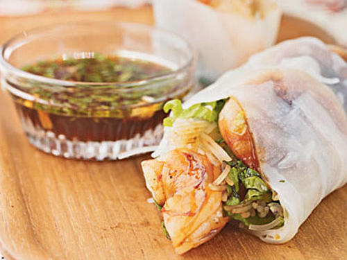 The fresh herbs, sweet shrimp, slight spicy heat, and crisp lettuce offer well-balanced taste and texture.