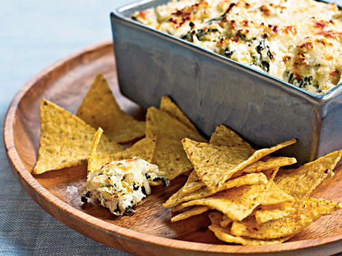 Appetizers can be the perfect way to begin a meal, or they can be the perfect small meal. Little bites can stave off hunger, allowing you to linger longer, or they can provide a light meal when heavier foods aren't appetizing. Regardless of how you choose to enjoy appetizers, vegetarian options like our Spinach-and-Artichoke Dip shine.
