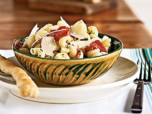 The spiral shape and grooved texture of cavatappi lets it hold on to lots of sauce and toppings, ensuring every bite of this dish is full of cheesy, porky, garlicky flavor and extra-virgin-olive-oil richness. A Caesar salad makes an excellent partner to this dish; try our pesto-enhanced version.