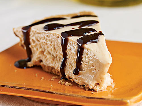 "Mary Frances Noveh from River Ridge, Louisiana, sent us this dessert recipe, which first appeared in December 2001. She noted it was like a ""peanut butter and chocolate candy bar."" We loved the results, and since it makes two pies, you can share one with a friend and keep the other for yourself. Several tasters in our Test Kitchens enjoy serving this pie frozen."
