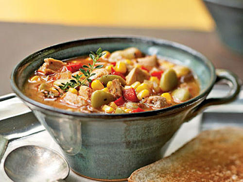 A Southern classic dish, our version features chicken, chopped bell pepper, lima beans, and corn in a tomato base. Serve with garlic bread and garnish with fresh thyme sprigs.