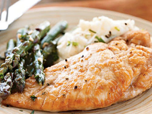 This tasty chicken and asparagus with white wine sauce is easy enough for a weeknight dinner but impressive enough for company. This recipe works equally well with green beans or haricots verts in place of asparagus.