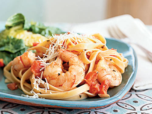 This easy shrimp fettuccine dish is an appealing, affordable option for entertaining. Add more or less red pepper depending on how much heat you prefer.