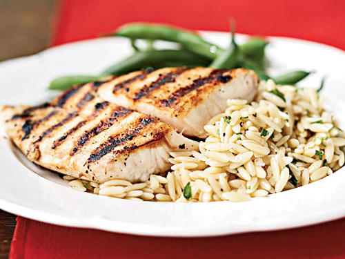 Nobody ever said grilling had to happen outdoors. This dish cooks on a grill pan, so you can make it even in the snowy depths of winter (but you can still fire up the charcoal if you want). A citrusy mustard vinaigrette adds big flavor to the orzo, but also pairs well with the char-grilled fish.