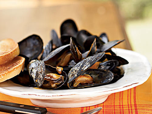 Mussels make any meal a special occasion, but they're so easy and quick to cook: This recipe, rich with cream and earthy saffron, takes about eight minutes total. Serve with a loaf of the best-quality French bread you can find for sopping up the sauce and briny juices.