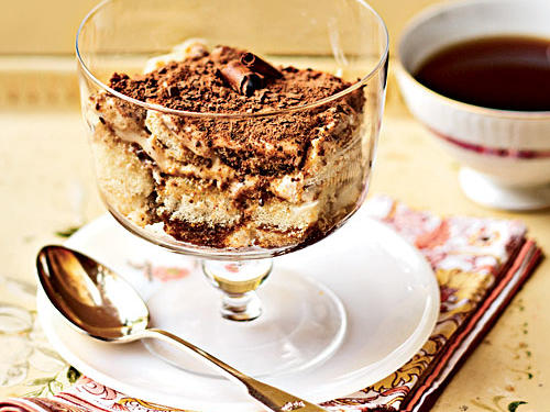 "Tiramisu is Italian for ""lift me up."" And its indulgent creamy, mocha-tinged flavor is indeed uplifting. With layers of ladyfingers, coffee, mascarpone cheese, and shaved or grated chocolate, traditional tiramisu is a cross between a trifle and bread pudding. Our lightened version is less than 300 calories per serving, and makes for a sophisticated dinner-party treat."