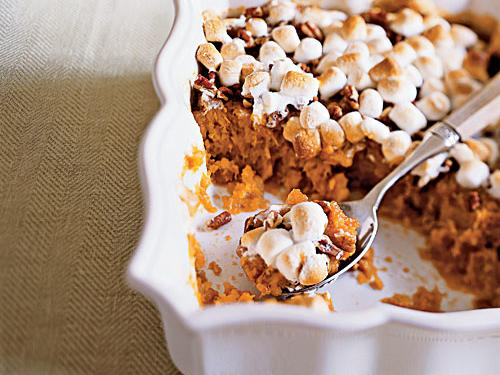 Rare is the Thanksgiving table that doesn't hold something very similar to this dish. The enduring combination of sweet potatoes mashed with butter and brown sugar and topped with toasted marshmallows is a taste everybody loves.