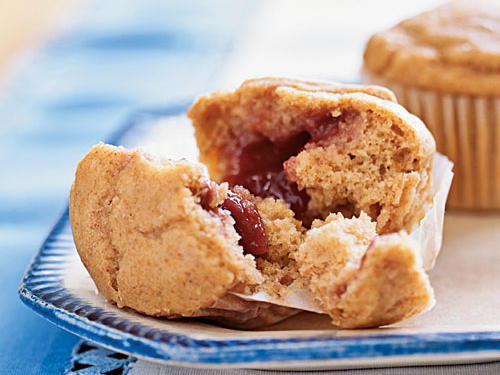 Consider these a breakfast version of a peanut butter and jelly sandwich. Don't use a natural-style peanut butter in this recipe; it won't have enough sugar or fat to help the muffins rise.